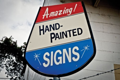 Hand painted advertising sign